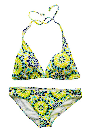 swimming costumes: Yellow graphic ornament bikini set isolated on white background.