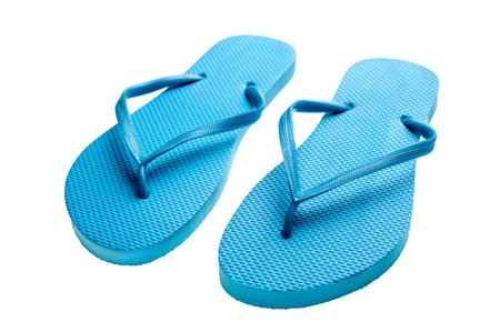 flipflops: Pair of blue flip-flops isolated on a white background. Stock Photo