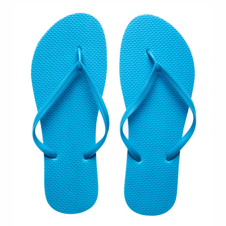 footware: Pair of blue flip-flops isolated on a white background. Stock Photo