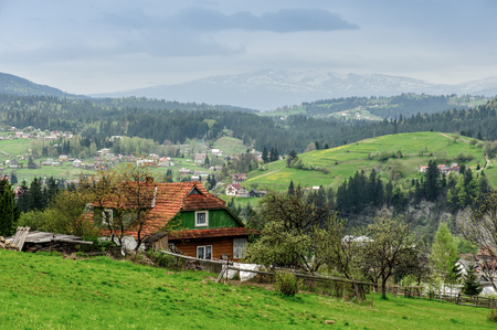 vorohta: Beautiful village in the valley of the Carpathian Mountains, Ukraine. Village house on foregrond.