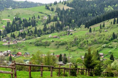 vorohta: Natural fence on the background of a mountain landscape. Photo taken in Vorohta village, Ukraine. Stock Photo