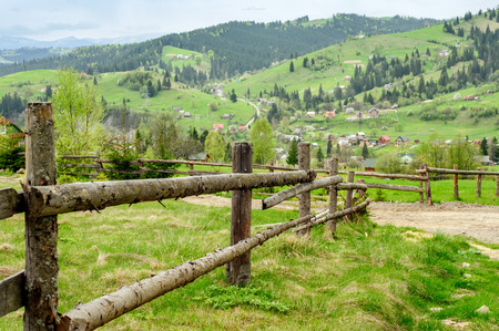 vorohta: Natural fence on the background of a mountain landscape.