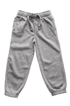 Gray children's sweatpants with ties isolated on the white Zdjęcie Seryjne - 49940376