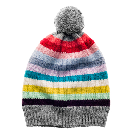 wools: Childrens striped knitted wool hat with pompon isolated on white background. Stock Photo