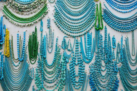 souvenir: A lot of turquoise beads at the showcase in a tourist shop in Egypt. Stock Photo