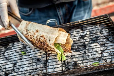 fish vendor: Cooking salmon kebab Turkish bazaar in Istanbul. Turkish man sells grilled fish to tourists.