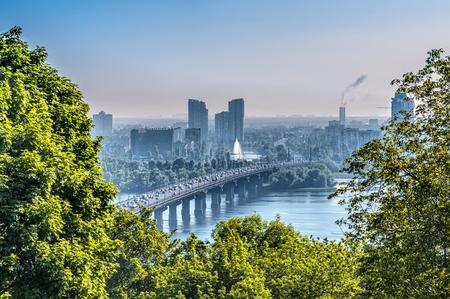 Aerial top view of Paton bridge and Dnieper river from Hryshko National Botanical Garden, Kiev, Ukraine.