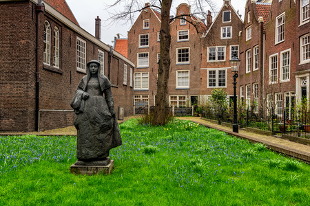 AMSTERDAM, NETHERLANDS - APRIL 9, 2018: Begijnhof is one of the oldest inner courts in the city of Amsterdam.