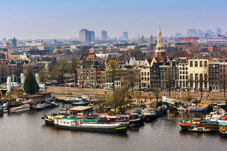 AMSTERDAM, NETHERLANDS - APRIL 10, 2018: Amsterdam skyline cityscape from the Oosterdok in the Netherlands. The Oosterdok is a chanel in Amsterdam . Stock Photo