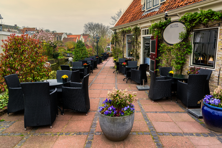 Hotel with restaurant terrace in a small city Edam in Netherlands. Edam is a small village in the district Nordholland, Netherlands.