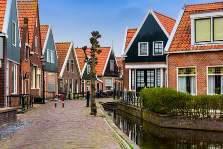 Traditional houses near canal in Holland town Volendam, Netherlands, in a spring day.