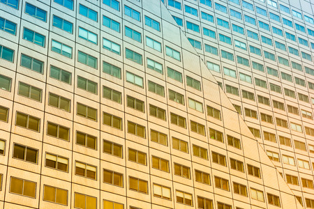 Wall of the building full of windows.