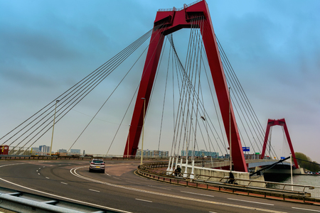 ROTTERDAM, NETHERLANDS - APRIL 13, 2018: The Willemsbrug is a bridge next to the Erasmusbrug in the centre of Rotterdam, spanning the Nieuwe Maas. Publikacyjne