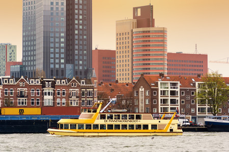 ROTTERDAM, NETHERLANDS - APRIL 13, 2018: Rotterdam embankment with skyscrapers and ships and the river Nieuwe Maas. Rotterdam is the second-largest city and a municipality of the Netherlands.
