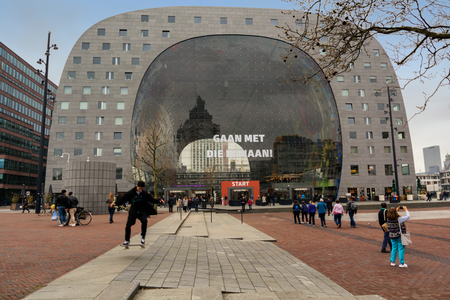 ROTTERDAM, NETHERLANDS - APRIL 13, 2018: The Markthal (English: Market Hall) is a residential and office building with a market hall underneath, located in Rotterdam.