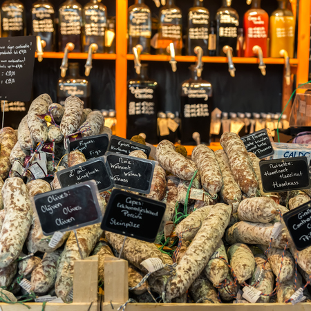 ROTTERDAM, NETHERLANDS - APRIL 13, 2018: A selection of sausages for sale on market in Rotterdam Netherlands. The Markthal (English: Market Hall) is a market hall underneath, located in Rotterdam. Publikacyjne