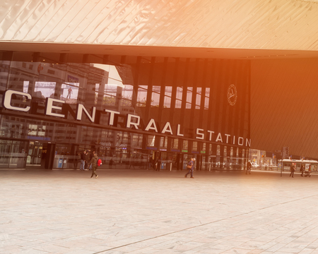 ROTTERDAM, NETHERLANDS - APRIL 13, 2018: Rotterdam Centraal is the main railway station of the city Rotterdam in the Netherlands. During sunset. Publikacyjne
