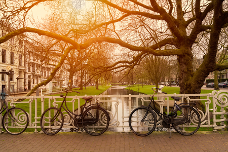 Bicycles on the city street river channel bridge in Rotterdam.