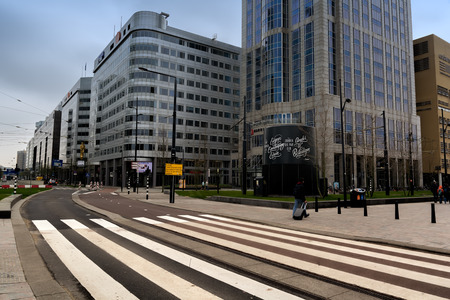 ROTTERDAM, NETHERLANDS - APRIL 13, 2018: Rotterdam city centre with futuristic buildings near Rotterdam Centraal station. Rotterdam is the second-largest city and a municipality of the Netherlands.