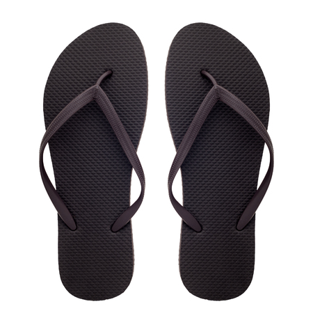 Brown rubber flip-flops isolated over white background, pair of thongs, shot above. Zdjęcie Seryjne