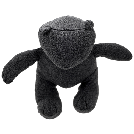 Gray Teddy Bear isolated on white background, shot from above. Postmodern toy.