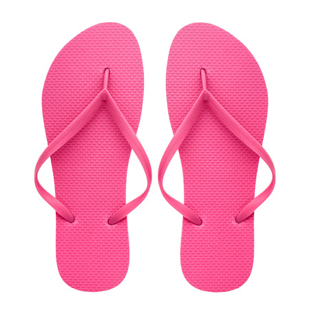 Pink rubber flip-flops isolated over white background, pair of thongs, shot above. Фото со стока