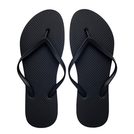 Black rubber flip-flops isolated over white background, pair of thongs, shot above. Zdjęcie Seryjne