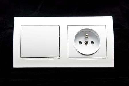 white electric switch and socket kit on theblack background photo