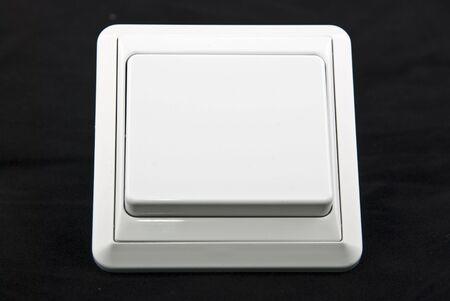 white light switch on the black background photo
