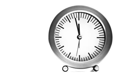 two minutes to midnight on clock isolated on white background