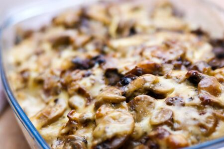 casserole dish: casserole with potato cheese and mushrooms