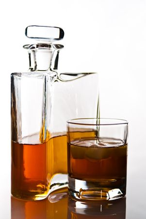 single carafe of scottish whisky or bourbon and drink with ice photo