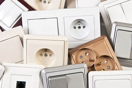 couple of electrical colorful switches and sockets photo