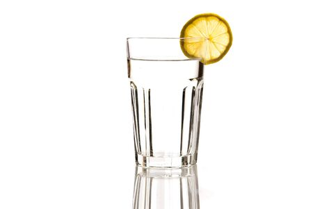 glass of mineral with lemon isolated on white Stock Photo
