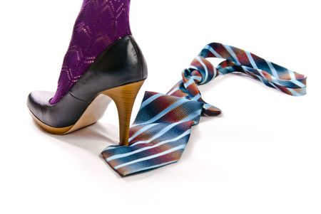 womans shoe on high heel tread colorful tie photo