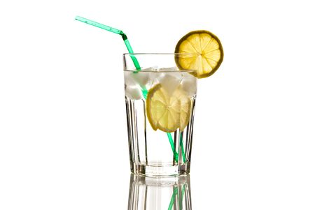glass of mineral water with lemon and ice isolated on white photo