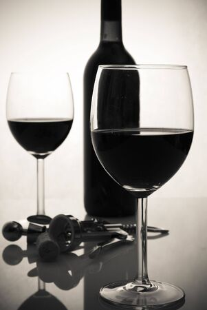 bottle of wine and wineglasses photo
