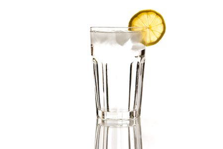 glass of mineral water with lemon and ice isolated on white Stock Photo