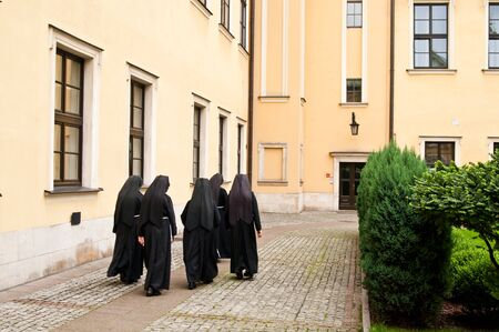 nuns walking on the square