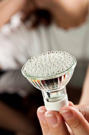 energy saving: bombilla de luz LED en mano  Foto de archivo