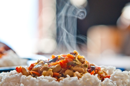chinese food chicken with vegetables with rice photo