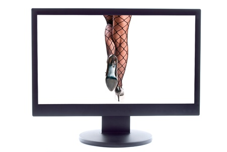 woman legs in pantyhose and shoes on high heels on TV screen photo