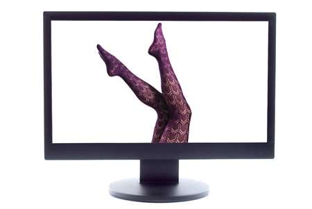 woman legs in pantyhose on TV screen photo
