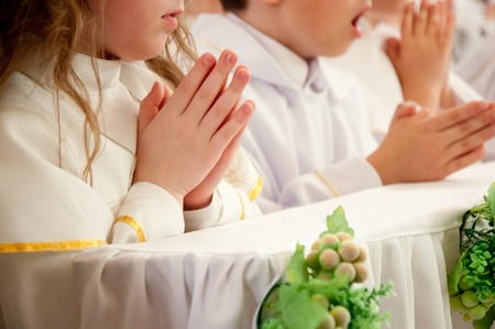 the first communion: children accepting the first Holy Communion