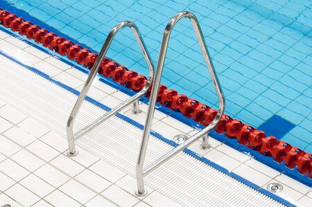 metal handrail: metal handrail on swimming pool