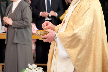 Catholic priest granting the Communion  photo