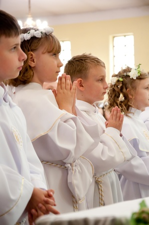 accepting: children accepting the first Holy Communion