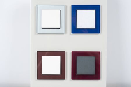 light switches on the wall with button on glass frame photo