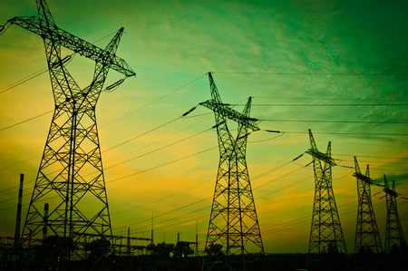 Pylon and transmission power line in sunset