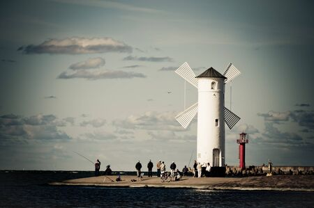 windmill on the seashore and cloudy sky